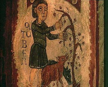 Riproduzione medievale di un contadino che da mangiare delle ghiande ai maiali